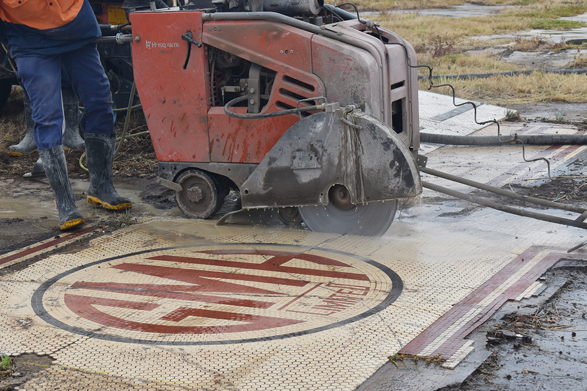Photo of cutting GM Holden mosaic with road saw.