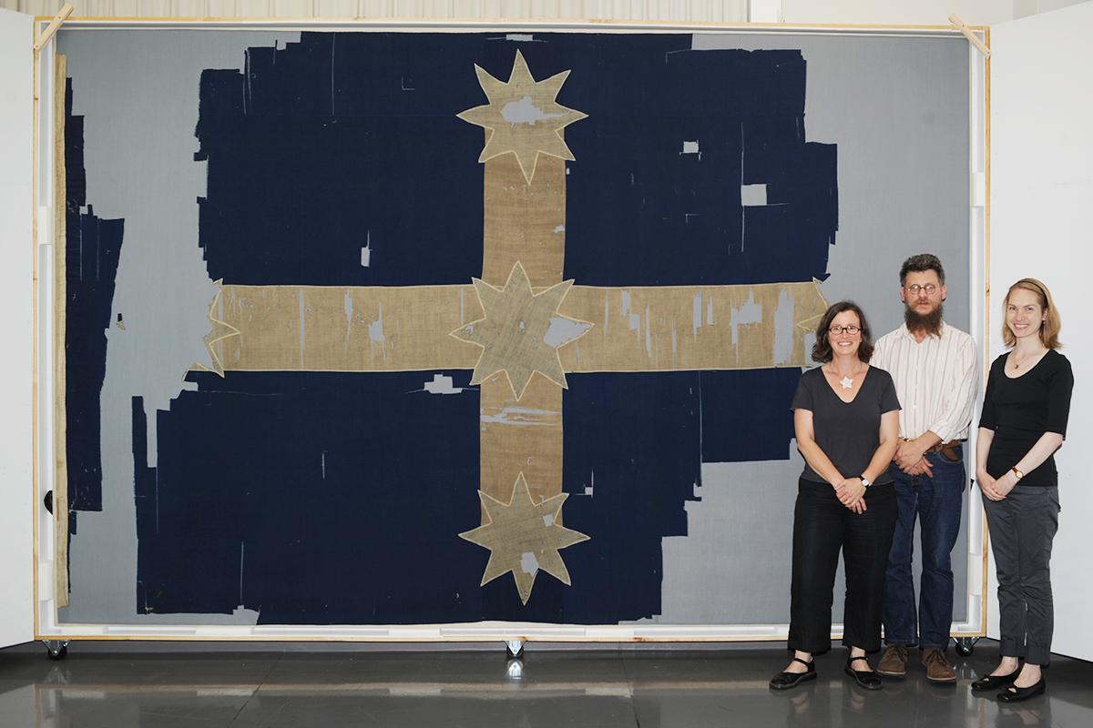 Conservators with Eureka Flag
