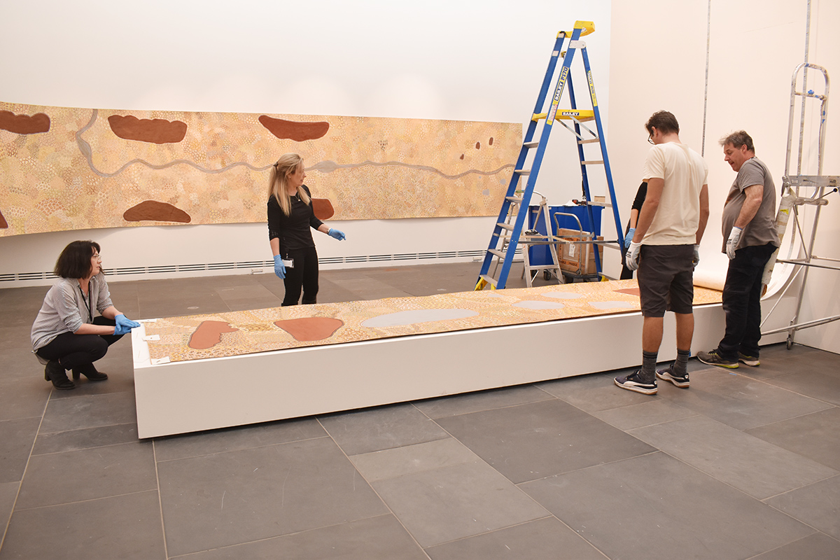 Installation of Standing on Country, Peggy Griffiths-Madij, Tarnanthi 2019, Art Gallery of South Australia, Adelaide with Artlab Paper Conservators and Art Gallery installation team. Image: Artlab Australia.