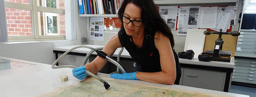 photo of lady conserving a map