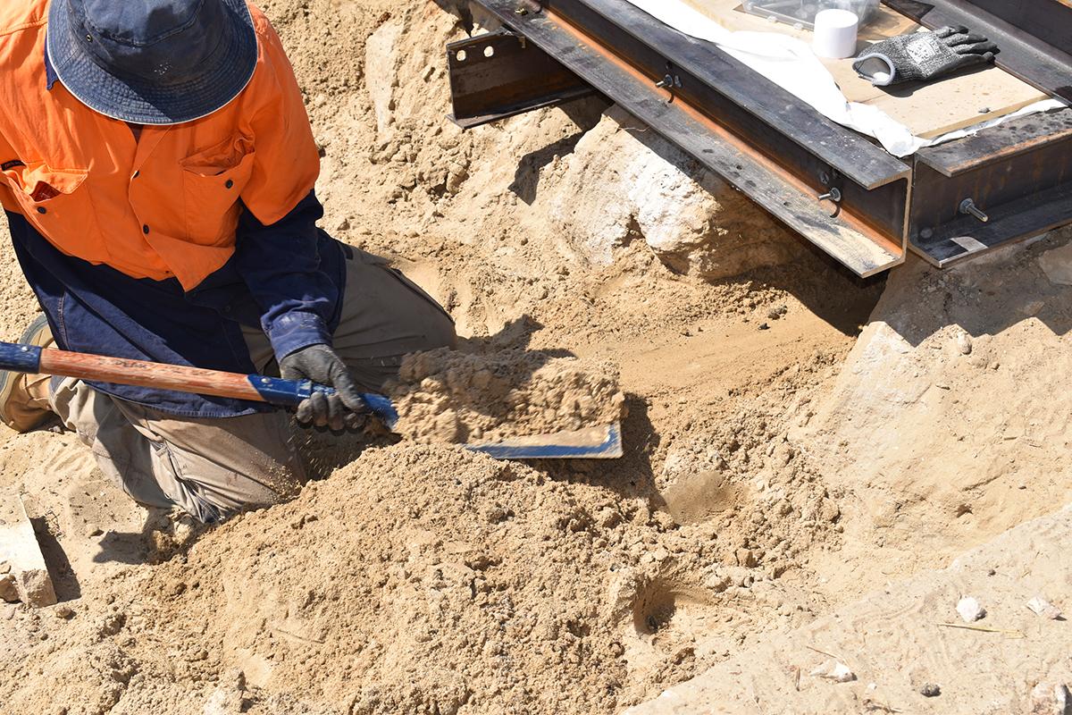 Photo of man digging
