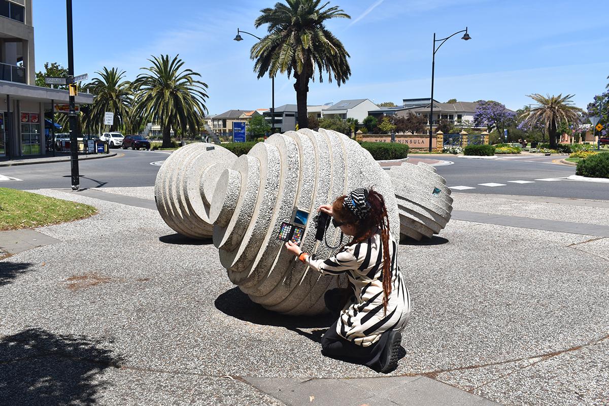 Conservator examining a sculpture