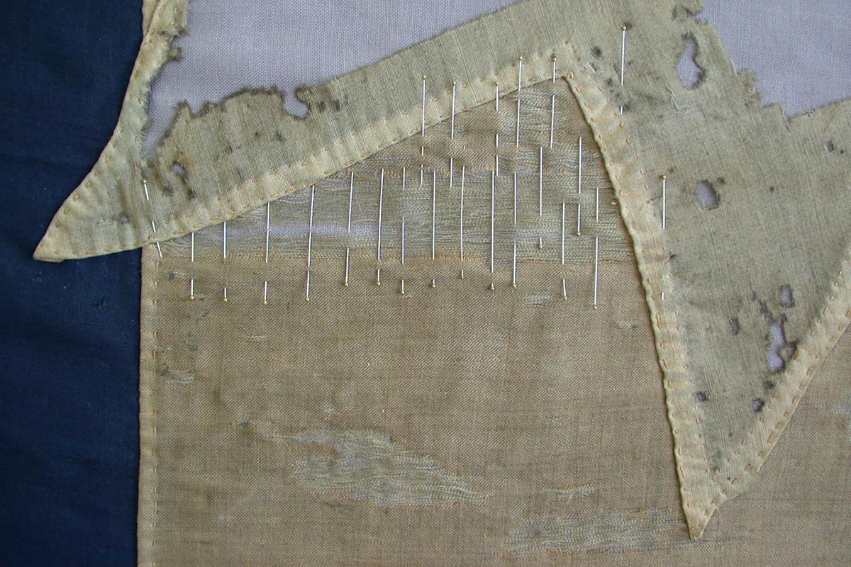 Detail of damage to flag