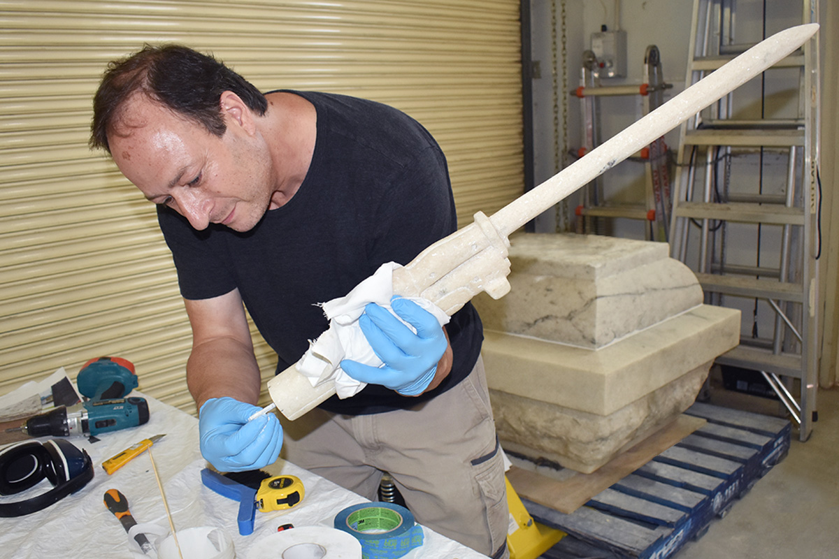 Conservator fixing part of monument