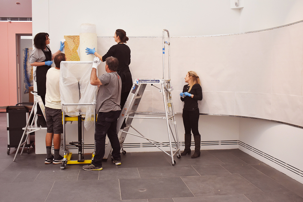 Installation of Being in Country – Woorrilbem to Thamberalm, Peggy Griffiths-Madij, Art Gallery of South Australia, Adelaide with Artlab Paper Conservators and Art Gallery installation team. Image: Artlab Australia