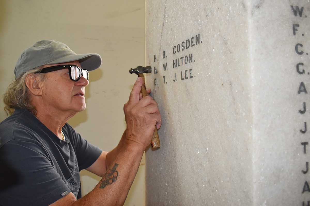 Fixing damaged lettering on memorial