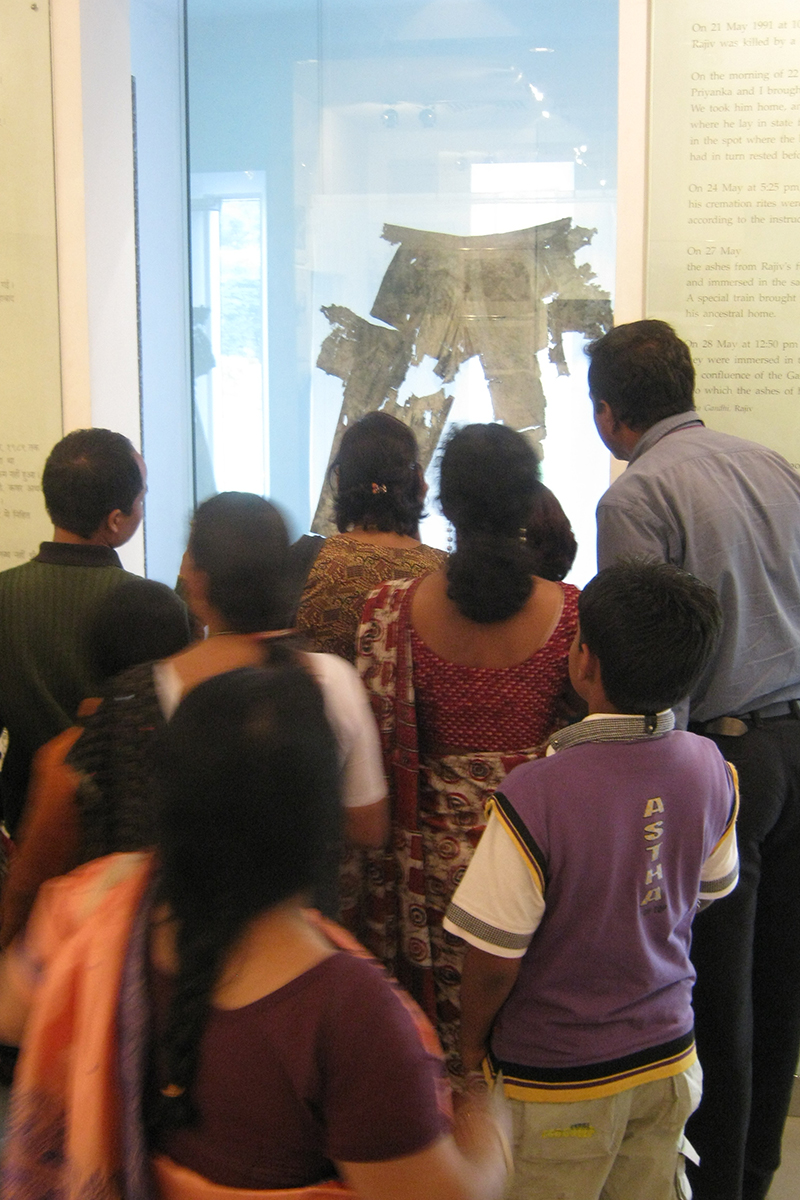 People looking at trousers on display