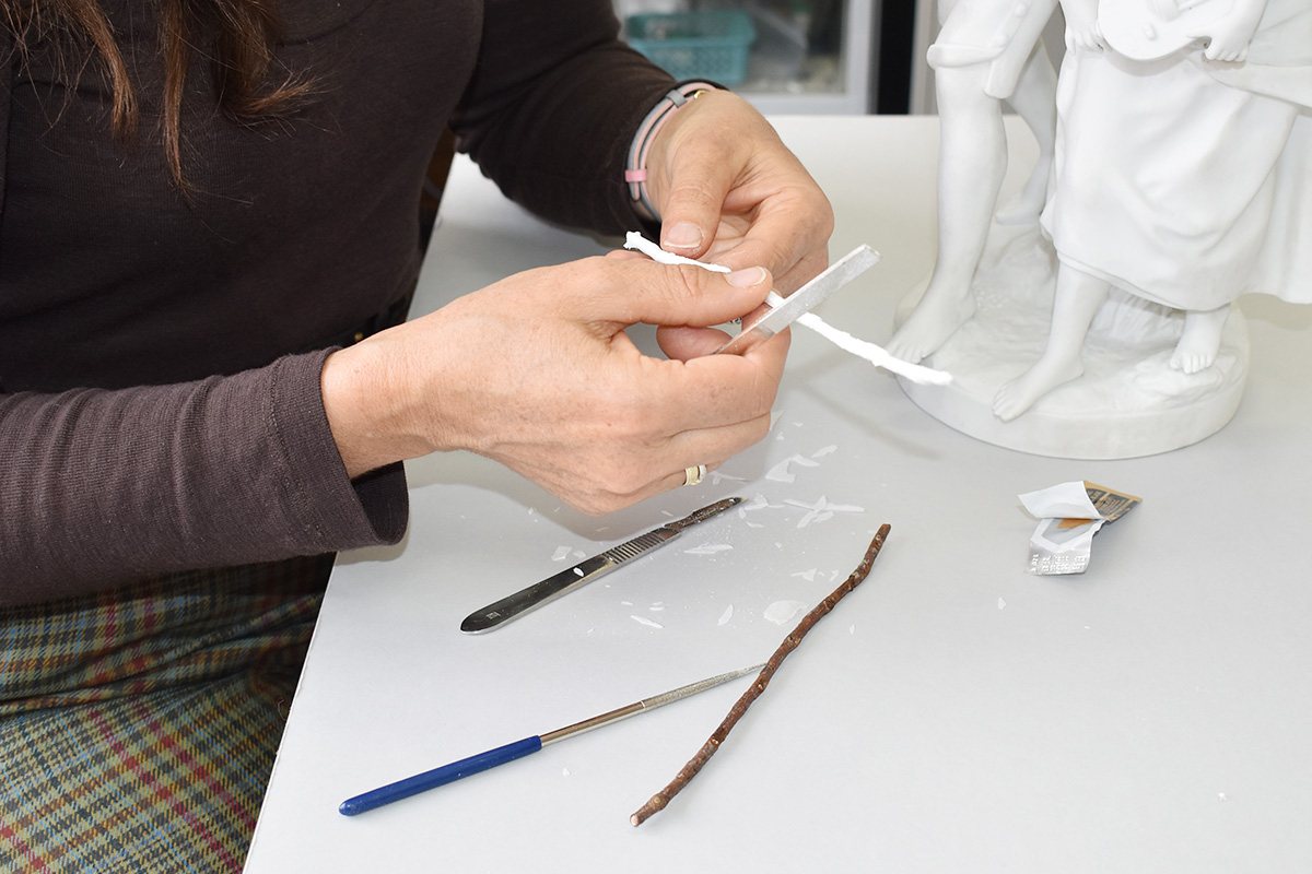 Sophie detailing the new cast before application to the statuette