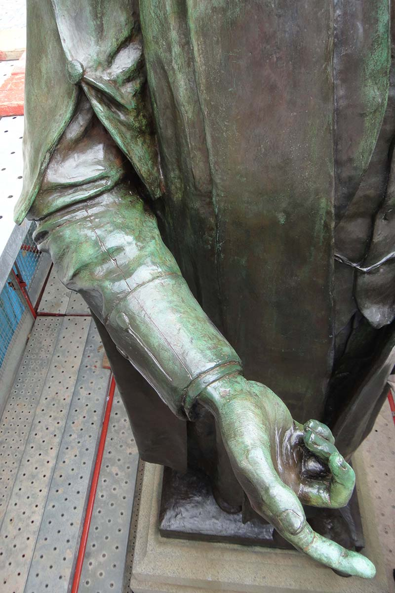 Detail of torso of memorial after conservation treatment